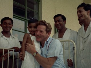 "Danny Kaye poses with a sick foreign child in the 1955 UNICEF short film ""Assignment Children."""