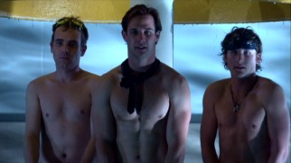 The boys of the football team (John White, Ryan Merriman, and Jesse Moss) are tricked into getting naked next to one another outside the Benjamin Dover High School pool.