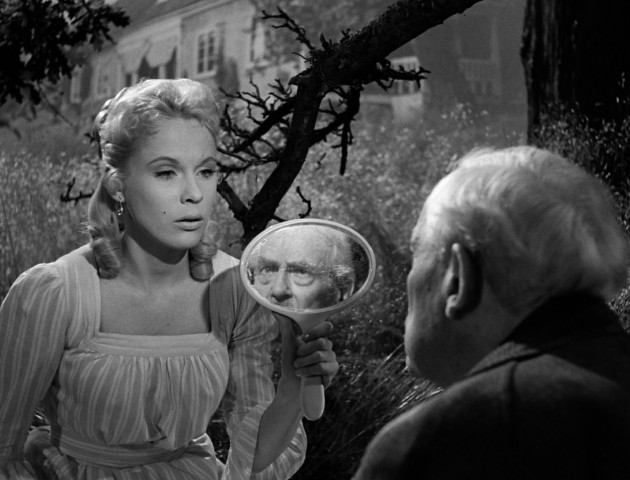 "Cousin Sara (Bibi Andersson) holds up a mirror to show Professor Isak Borg (Victor Sjöström) his old self in Ingmar Bergman's ""Wild Strawberries."""