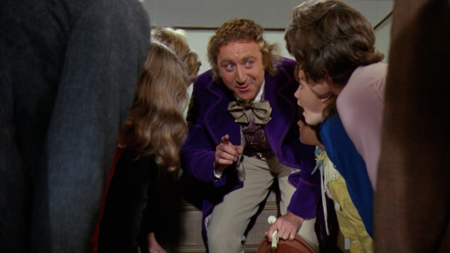 The Willy Wonka's funhouse-like Chocolate Factory requires the tour to crouch down to fit in shrinking hallway, a scene employed as the Blu-ray's one menu.