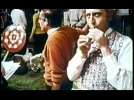 "Gene Wilder practices his flute-playing skills in between takes on the Chocolate Room set, a sight captured in ""A World of Pure Imagination."""