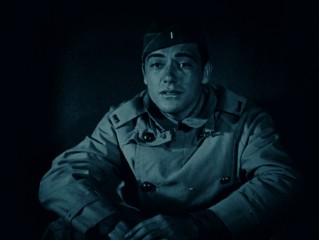 "Jack Powell (Charles ""Buddy"" Rogers) looks into a rescue of his friend in one of the film's blue-tinted sequences."