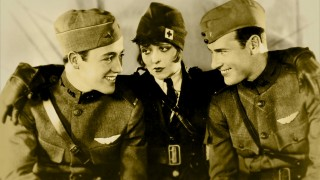 "The three leads of ""Wings"" -- Charles ""Buddy"" Rogers, Clara Bow, and Richard Arlen -- pose together on the film's Blu-ray menu."