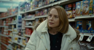 Mike's wife Jackie Flaherty (Amy Ryan) finds herself warming to her young extended houseguest on a shared supermarket run.