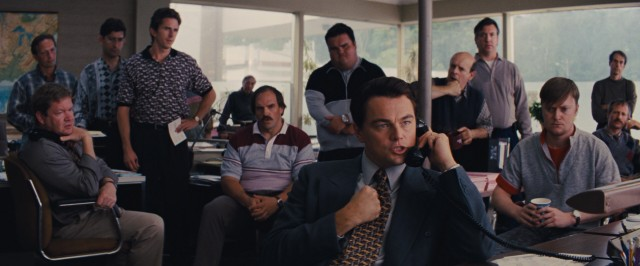 Jordan Belfort (Leonardo DiCaprio) wows everyone with his ability to sell junk penny stocks to desperate people his first day on the job at strip mall Investor Services.