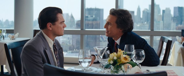 At lunch on his first day on the job, Jordan (Leonardo DiCaprio) receives some questionable advice from his mentor, Mark Hanna (Matthew McConaughey).