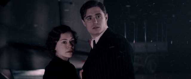 In a 1940s flashback, the young Maria Altmann (Tatiana Maslany) and her husband (Max Irons) fear an obstacle as they are about to board a plane for Cologne, France.