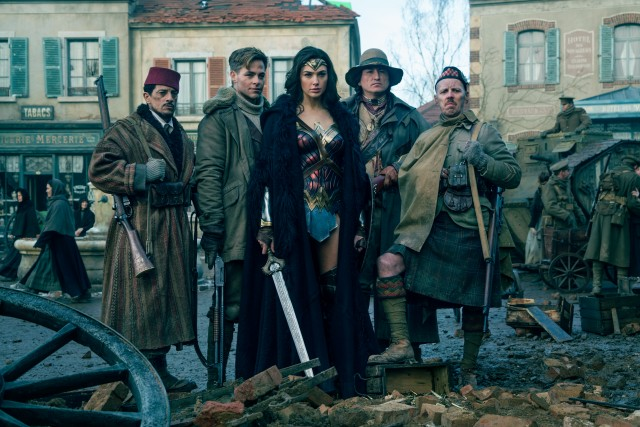 Diana Prince (Gal Gadot) poses with her multicultural allies (Said Taghmaou, Chris Pine, Eugene Brave Rock, and Ewen Bremner).
