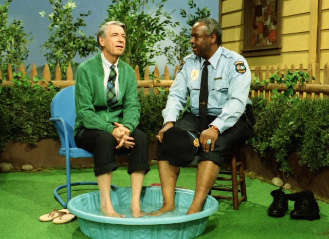 "As they did before, Mr. Rogers (Fred Rogers) and Officer Clemmons (François Clemmons) cool their feet off together in a kiddie pool in a ""Mister Rogers' Neighborhood"" clip seen in the documentary ""Won't You Be My Neighbor?"""