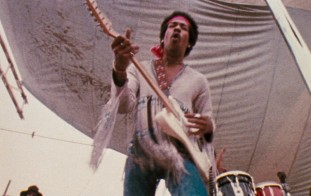 Jimi Hendrix brings Woodstock into a fourth day of peace and music with his concert-closing Monday morning performance to a significantly diminished crowd.