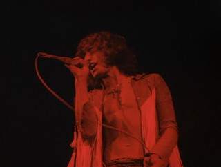 "A red-lit Roger Daltrey sings The Who's ""We're Not Gonna Take It"" in full as part of Disc 2's epic Untold Stories section."
