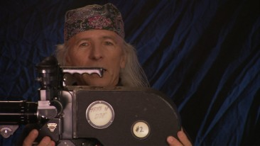 "Director Michael Wadleigh shows off the cumbersome camera he used to shoot Woodstock in a ""Woodstock: From Festival to Feature"" short."
