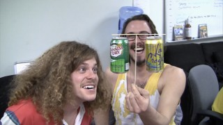 "Kyle Newacheck amuses Blake Anderson with his soft drink can balancing act in ""Behind the Scenes in the Writers Room."""