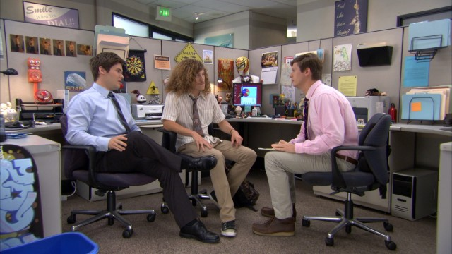 Adam (Adam DeVine), Blake (Blake Anderson), and Anders (Anders Holm) hatch a plan in their shared work cubicle.
