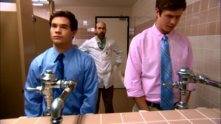 A close eye is kept on Adam and Anders as they urinate for the company drug test.