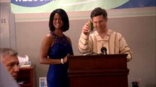 After partying with this Michelle Obama look-alike (Jefandi Cato), TelAmeriCorp CEO Bruce Benson (Chris Parnell) changes his plans for the company.