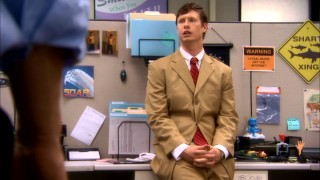 Anders' (Anders Holm) push for a promotion includes wearing this wrinkled tan suit and promising a PowerPoint presentation.