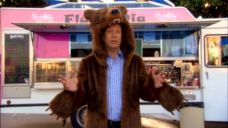 """Double Dare"" host Marc Summers tapes an ""Unwrapped"" segment in a bear coat in the show's apex of early '90s cultural references."