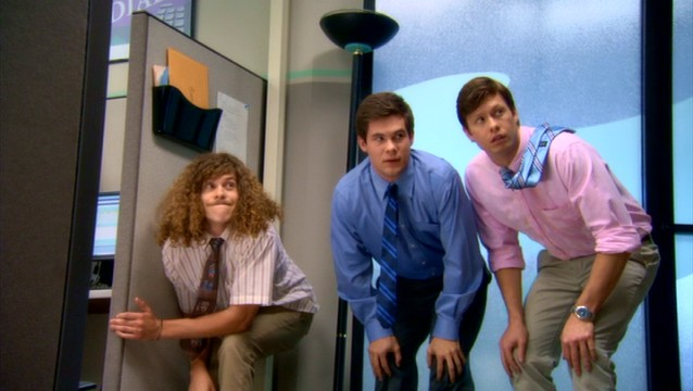 Blake (Blake Anderson), Adam (Adam DeVine), and Anders (Anders Holm) try to avoid notice while holding a suspiciously crouched position.