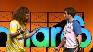Blake Anderson and Adam DeVine perform a live stage sketch at the 2011 Bonnaroo Music Festival.