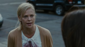 A wine spill on her blouse is the catalyst to Mavis (Charlize Theron) exploding.