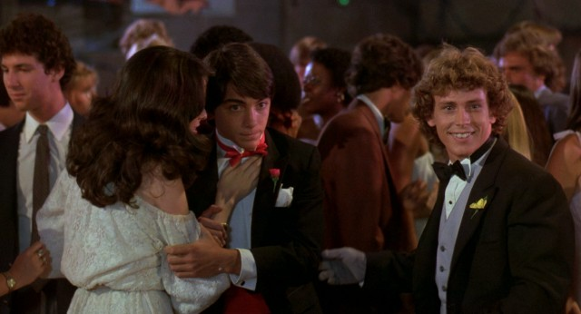 Barney (Scott Baio) uses his powers to make clothes disappear in the film's climax, set in Emerson High School's senior prom.