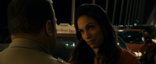 ...that he's hardly noticed Dr. Kate Cooper (Rosario Dawson), the more compassionate bachelorette willing to tilt her head at him.